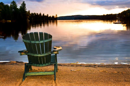 Wooden chair on beach of relaxing lake at sunset Фото со стока - 6265685