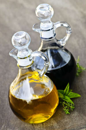 cooking oil: Oil and balsamic vinegar glass bottles with spouts Stock Photo