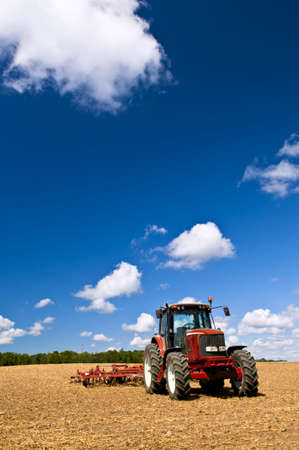 agricultural machinery: Small scale farming with tractor and plow in field