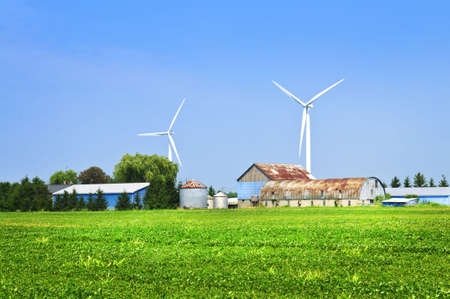 Green alternative clean power wind turbines on farm photo