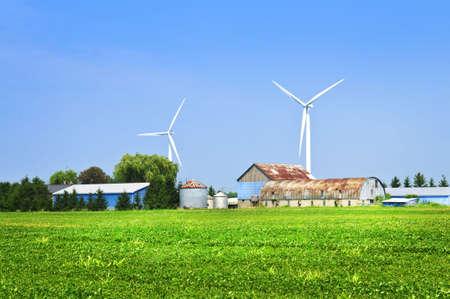 Green alternative clean power wind turbines on farm photo