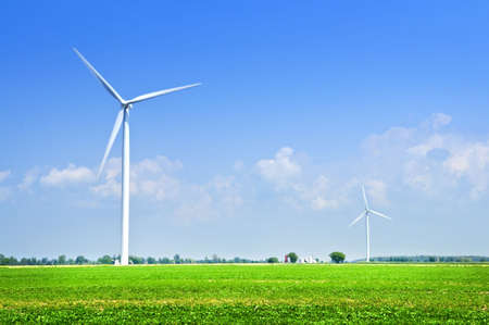 Green alternative clean power wind turbines in field Stock Photo - 6278620