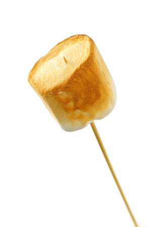 toasted: Golden toasted marshmallow on a wooden skewer Stock Photo