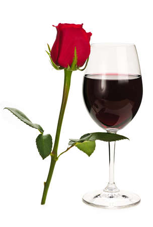 Romantic glass of red wine with long stemmed rose photo