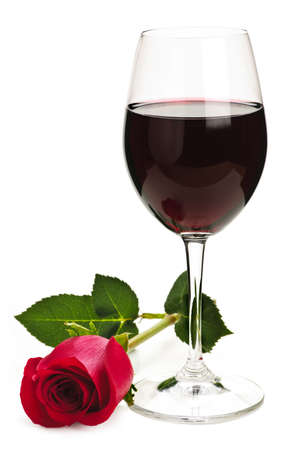 Romantic glass of red wine with long stemmed rose isolated on white background