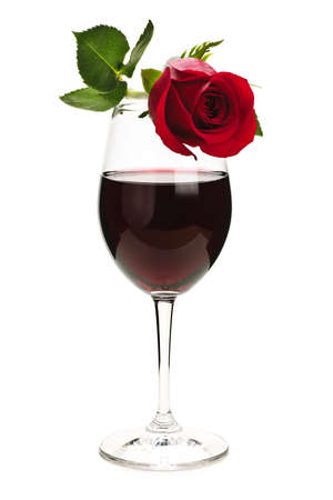 white wine: Romantic  rose on top of  red wine glass isolated on white background