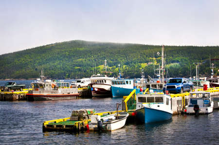 Harbor with various fishing boats in Newfoundland Canada photo
