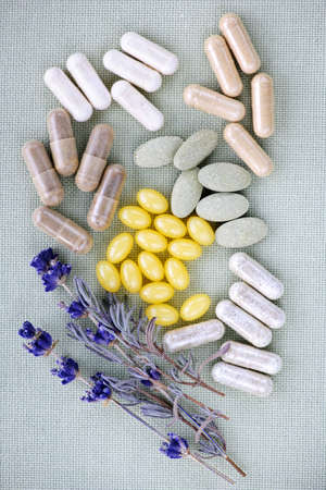 herbology: Mix of herbal supplements and vitamin pills