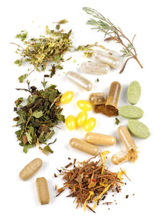 herbology: Herbs,  herbal supplements and vitamin pills on white background Stock Photo