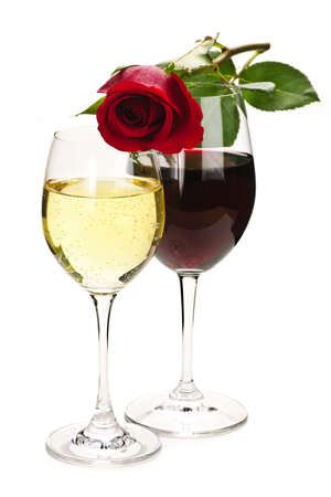 white wine: Romantic rose on top of red and white wine glasses isolated on white background Stock Photo