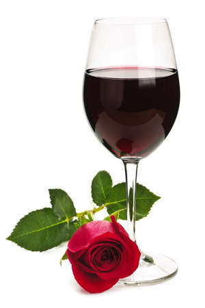 Romantic glass of red wine with long stemmed rose isolated on white background photo