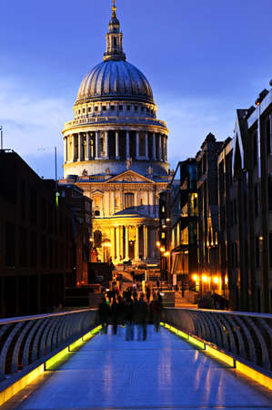 View of St. Pauls Cathedral in London from Millennium Bridge at night Stock Photo