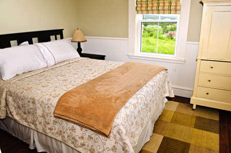 luxury hotel room: Bedroom interior with comfortable queen size bed with view