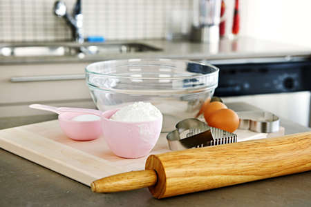Cookie baking utensils and ingredients in kitchen at home photo