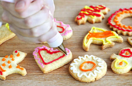 shortbread: Decorating homemade shortbread cookies with icing from piping bag