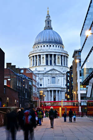 View of St. Pauls Cathedral in London from street at dusk photo