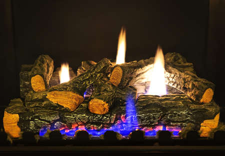 Close up of logs in gas fireplace Stock Photo - 6477804