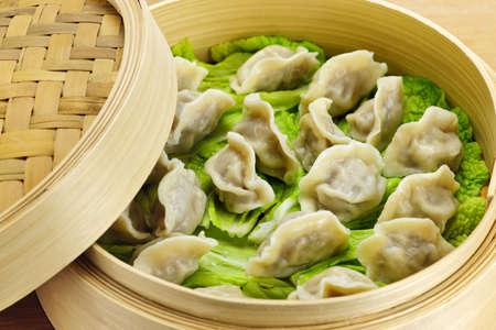 dumpling: Closeup of bamboo steamer with cooked dumplings