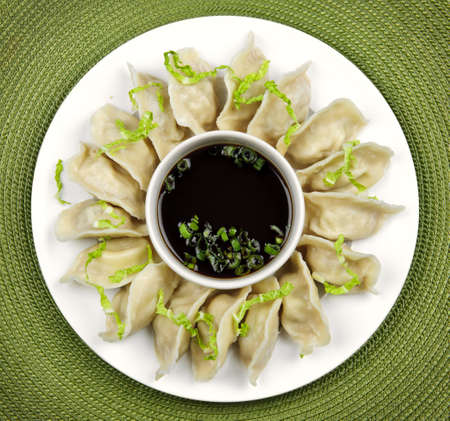 Plate of steamed dumplings with soy sauce from above Reklamní fotografie