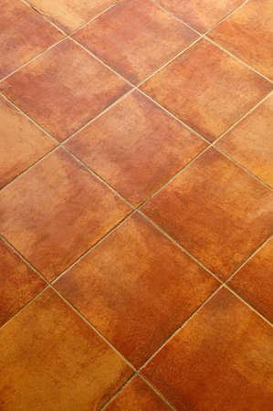 Closeup of square terracotta ceramic tile floor background photo