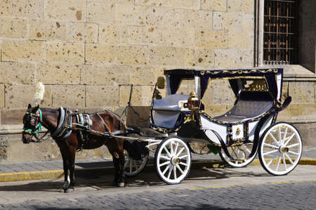 horse carriage: Horse drawn carriage waiting for tourists in historic Guadalajara, Jalisco, Mexico Stock Photo