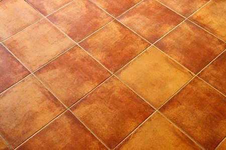 Closeup of square terracotta ceramic tile floor background Archivio Fotografico