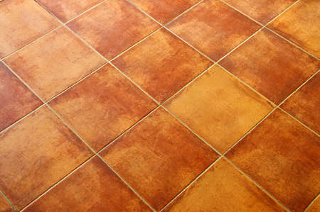 terracotta: Closeup of square terracotta ceramic tile floor background Stock Photo