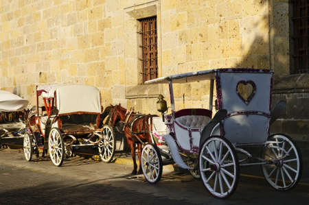horse drawn carriage: Horse drawn carriages waiting for tourists in historic Guadalajara, Jalisco, Mexico