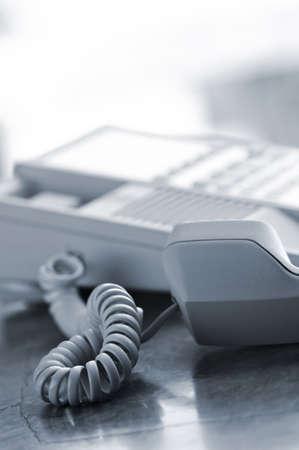 handset: Telephone handset off the hook on desk Stock Photo