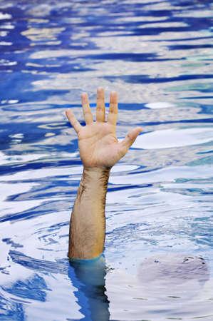 needing: Hand of drowning man needing help and assistance Stock Photo