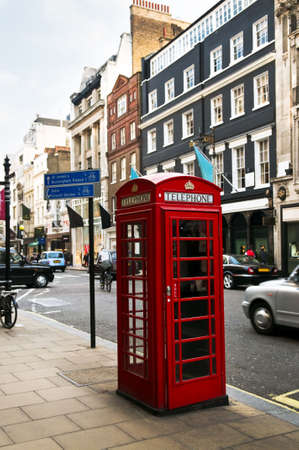 Red telephone box on busy London street in England Stock Photo - 6621524