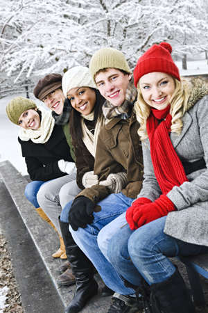 Group of diverse young friends outdoors in winter photo