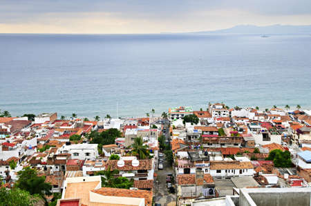 puerto: View of rooftops and Pacific ocean in Puerto Vallarta, Mexico Stock Photo