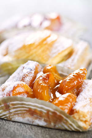 flaky: Closeup on slices of flaky fruit strudel desserts Stock Photo