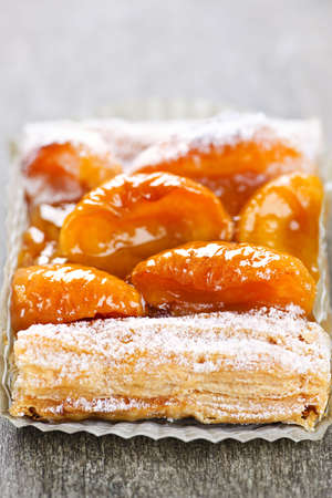 flaky: Closeup on slice of flaky apricot strudel pastry dessert