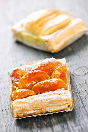 flaky: Closeup on two slices of flaky fruit strudel desserts