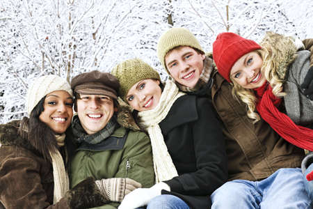 winter jacket: Group of diverse young friends outdoors in winter