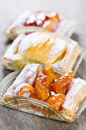 strudel: Closeup on slices of flaky fruit strudel desserts Stock Photo