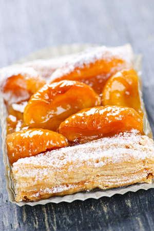 strudel: Closeup on slice of flaky apricot strudel pastry dessert