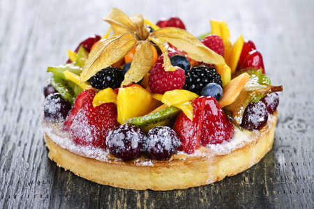 Fresh dessert fruit tart covered in assorted tropical fruits