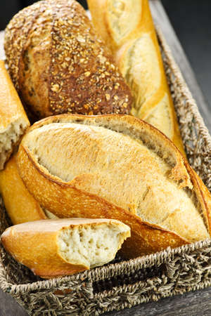 Various kinds of fresh baked bread in basket Stock Photo - 6754367
