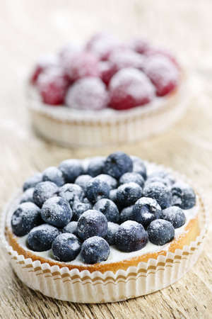 Closeup of fancy gourmet fresh berry dessert tarts Stock Photo - 6754438