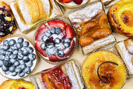sweet pastries: Background of assorted fresh sweet tarts and pastries from above