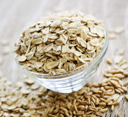 heaping: Nutritious rolled oats heaped in a glass bowl Stock Photo