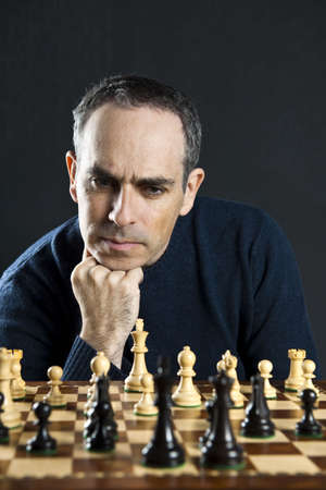 Chessboard with man thinking about chess strategy Stock Photo - 6811633
