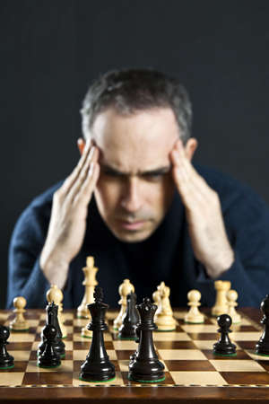 Chessboard with man thinking about chess strategy Stock Photo - 6811639