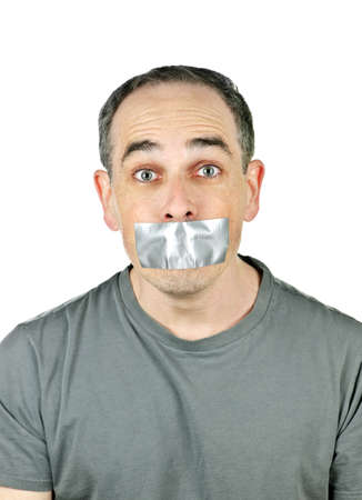 Portrait of man with duct tape over his mouth photo