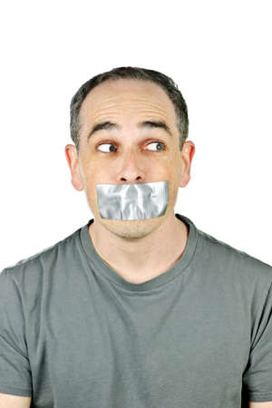 Portrait of man with duct tape over his mouth glancing sideways photo