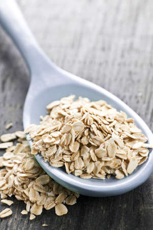 heaped: Nutritious rolled oats heaped on a spoon Stock Photo