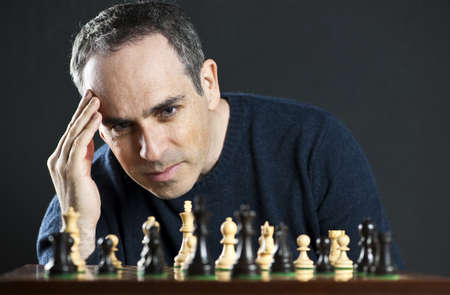Chessboard with man thinking about chess strategy Stock Photo - 6856883